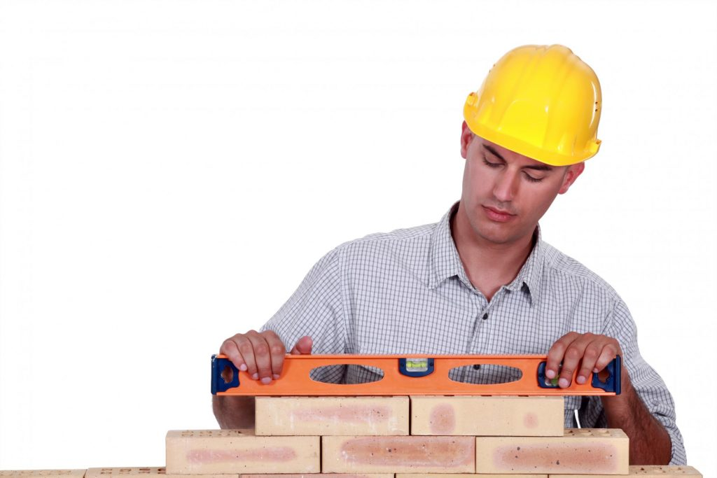 man holding a level tool