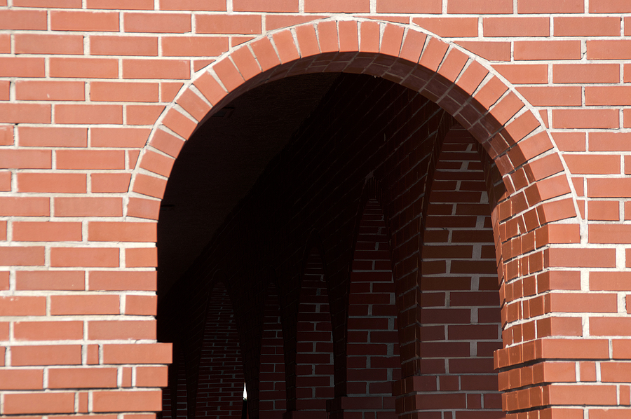 finely crafted bricks of an walkway tunnel archway